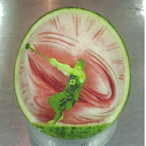 watermelon sculpture: Hammer throw.