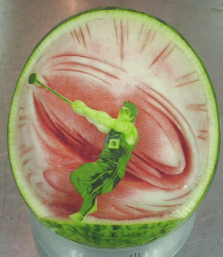 Watermelon Carving: Hammer throw.